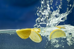 Fresh lemon  in water Royalty Free Stock Photography