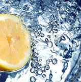 Fresh lemon in water Royalty Free Stock Photos