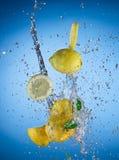 Fresh lemon with water splash Stock Photos