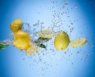 Fresh lemon with water splash Royalty Free Stock Images
