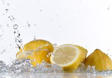 Fresh lemon with water splash Royalty Free Stock Photos