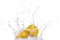 Fresh lemon in water splash on white backround Royalty Free Stock Photography