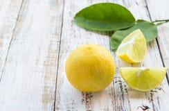Fresh lemon on white wooden table Royalty Free Stock Photos