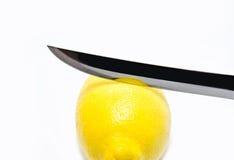 Fresh lemon whith khife royalty free stock photography
