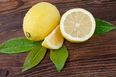 Fresh Lemon on Wooden background Stock Photo