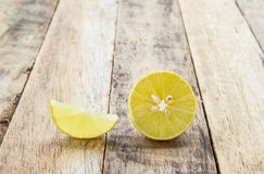 Fresh lemon on wooden table background Royalty Free Stock Images