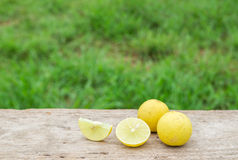 Fresh lemon on wooden table background Royalty Free Stock Photography