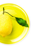 Fresh lemon on yellow plate isolated on white Stock Images