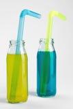 Fresh lemonade with citrus fruits on white wooden background. Glass soda bottles isolated on white background Stock Image