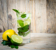 Fresh lemonade drink with ice. Fruit. Lemon lime and green mint Royalty Free Stock Photography