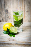 Fresh lemonade drink with ice. Fruit. Lemon lime and green mint Royalty Free Stock Photos