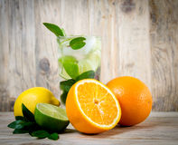 Fresh lemonade drink with ice. Fruit. Orange lemon lime and gree Royalty Free Stock Images