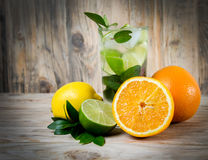 Fresh lemonade drink with ice. Fruit. Orange lemon lime and gree Royalty Free Stock Photo