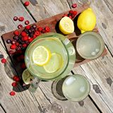 Fresh Lemonade and Fruit Framing Rustic Wood Background Royalty Free Stock Images