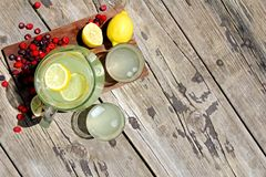 Fresh Lemonade and Fruit Framing Rustic Wood Background Stock Images