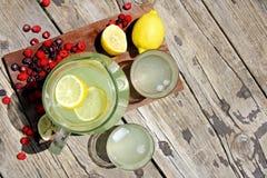 Fresh Lemonade and Fruit Framing Rustic Wood Background Royalty Free Stock Photo