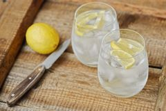 Fresh lemonade with ice and lemon on the table. View royalty free stock image