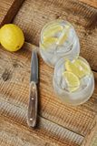 Fresh lemonade with ice and lemon on the table. View stock photo