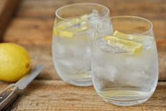 Fresh lemonade with ice and lemon on the table. View royalty free stock images