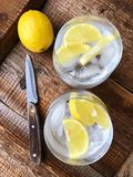 Fresh lemonade with ice and lemon on the table. View royalty free stock photography