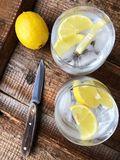 Fresh lemonade with ice and lemon on the table. View stock images