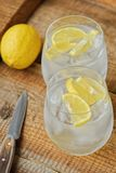 Fresh lemonade with ice and lemon on the table. View stock photography