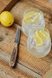 Fresh lemonade with ice and lemon on the table. View stock photos