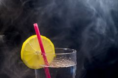 Fresh lemonade, lemon and drinking straw royalty free stock images