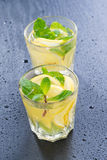 Fresh lemonade with mint in glasses on a dark background Royalty Free Stock Image