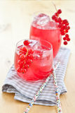 Fresh lemonade with red currant. Fresh lemonade with ice cubes and red currant royalty free stock photo