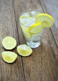 Fresh lemonade and soda in a glass on a wooden Stock Photo
