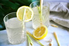 Fresh Lemongrass Aroma Drinks with Fresh Lemon. Glasses of fresh lemongrass aroma drinks with fresh lemon and raw lemongrass on background stock images