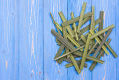 Fresh lemongrass or citronella grass leaf on blue wooden plank Royalty Free Stock Images