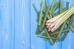 Fresh lemongrass or citronella grass leaf on blue wooden plank Stock Photos