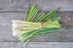 Fresh lemongrass (citronella) on wooden background. Fresh lemongrass (citronella) on wooden background - Spice for health stock image