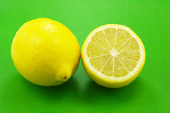 Fresh lemons. On green background Royalty Free Stock Photography
