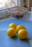Fresh lemons on a blue background portrait wide Royalty Free Stock Images