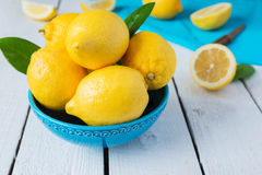 Lemons in blue bowl Royalty Free Stock Photos
