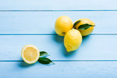 Fresh lemons on blue wooden table Royalty Free Stock Photo