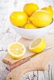 Fresh lemons in a bowl and knife Stock Photo