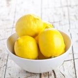 Fresh lemons in a bowl Stock Photo
