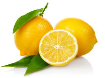 Fresh lemons with cut and green leaves Royalty Free Stock Images