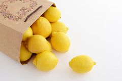 Fresh lemons. Fresh and delicious lemons in the paper bagn Stock Photography