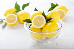 Fresh lemons in a glass bowl Royalty Free Stock Photos
