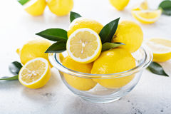 Fresh lemons in a glass bowl Royalty Free Stock Photography