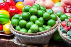 Fresh  Lemons green  in basket. Royalty Free Stock Photography