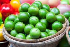 Fresh  Lemons green  in basket. Royalty Free Stock Photo
