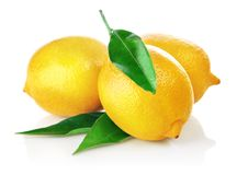Fresh lemons with green leaves Royalty Free Stock Photography