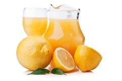 Fresh lemons and juice Stock Photos