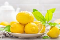 Fresh lemons with lemon leaves Stock Photos